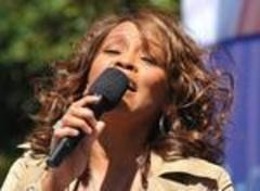 Woman singing Whitney Houston songs escorted off AA flight