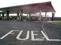 Motorway service stations forced to advertise petrol prices of rivals on the hard shoulder to stop drivers being ripped off